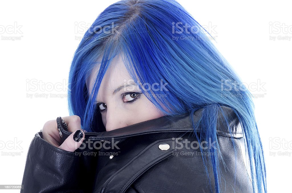 Blue haired teen hiding behind jacket collar royalty-free stock photo