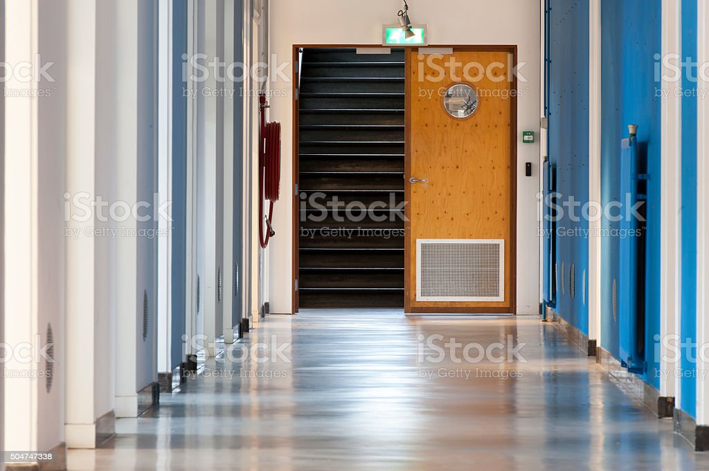 Blue hallway in an abondoned office building stock photo