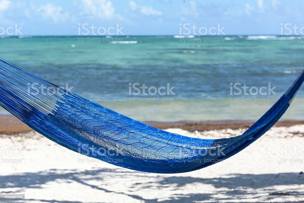 Blue Hammock Overlooking the Caribbean Sea, Tulum, Mexico stock photo