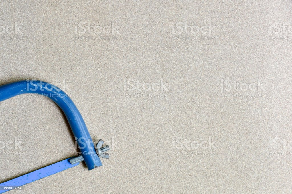blue hand hack saw tool for metal cut stock photo