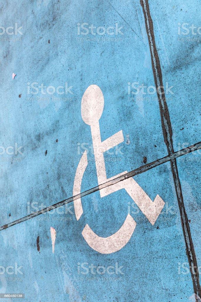 blue handicap sign at a parking lot stock photo
