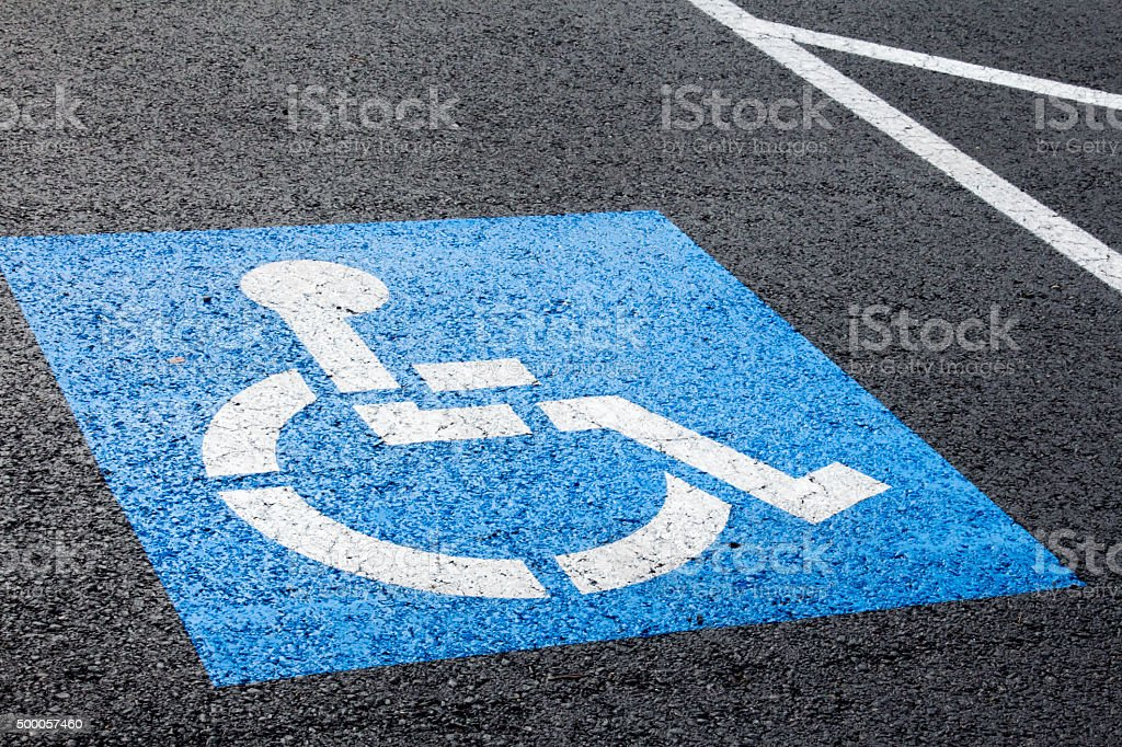 Blue handicapped parking spot stock photo