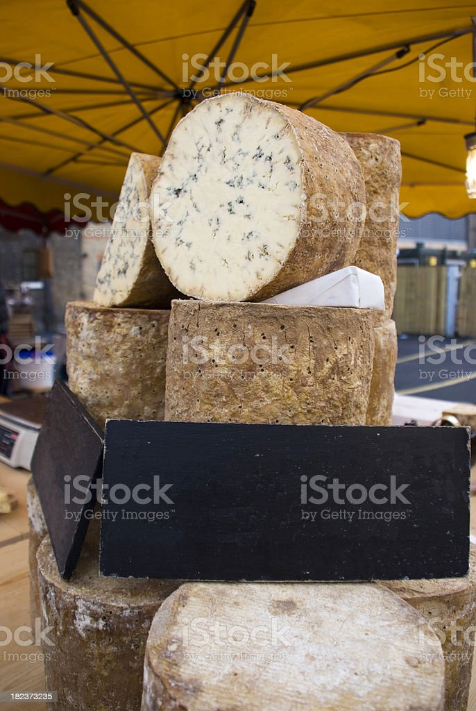 Blue hard cheese at open market stock photo