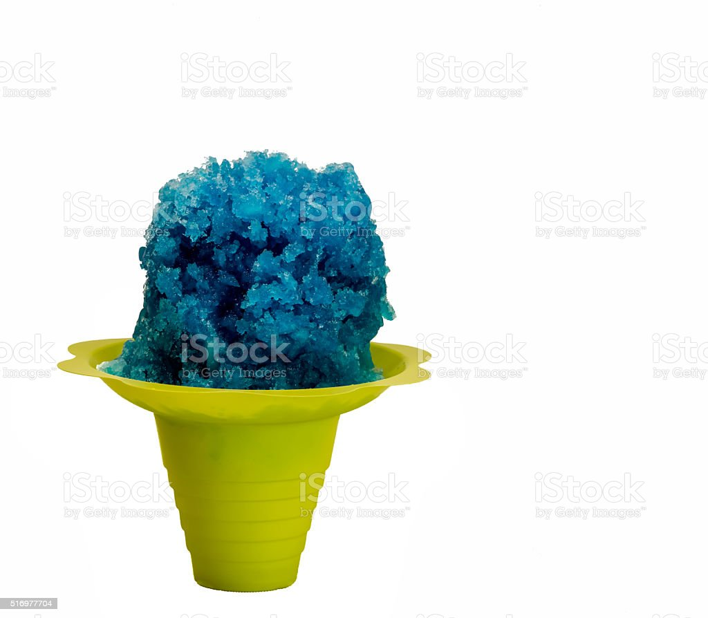 Blue Hawaiian shaved ice, snow cone in a Flower Cup. stock photo