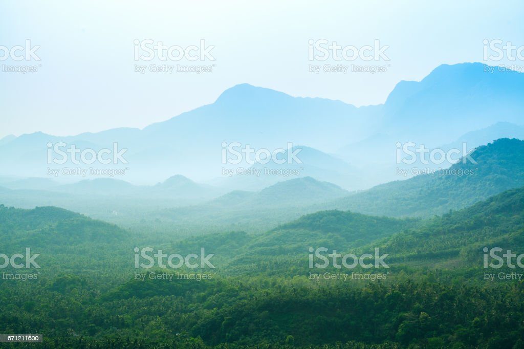 Blue haze mountain landscape stock photo