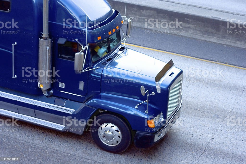 Blue head of a transport truck on a concrete road royalty-free stock photo