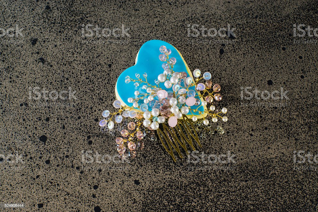 Blue heart with handmade barrette stock photo