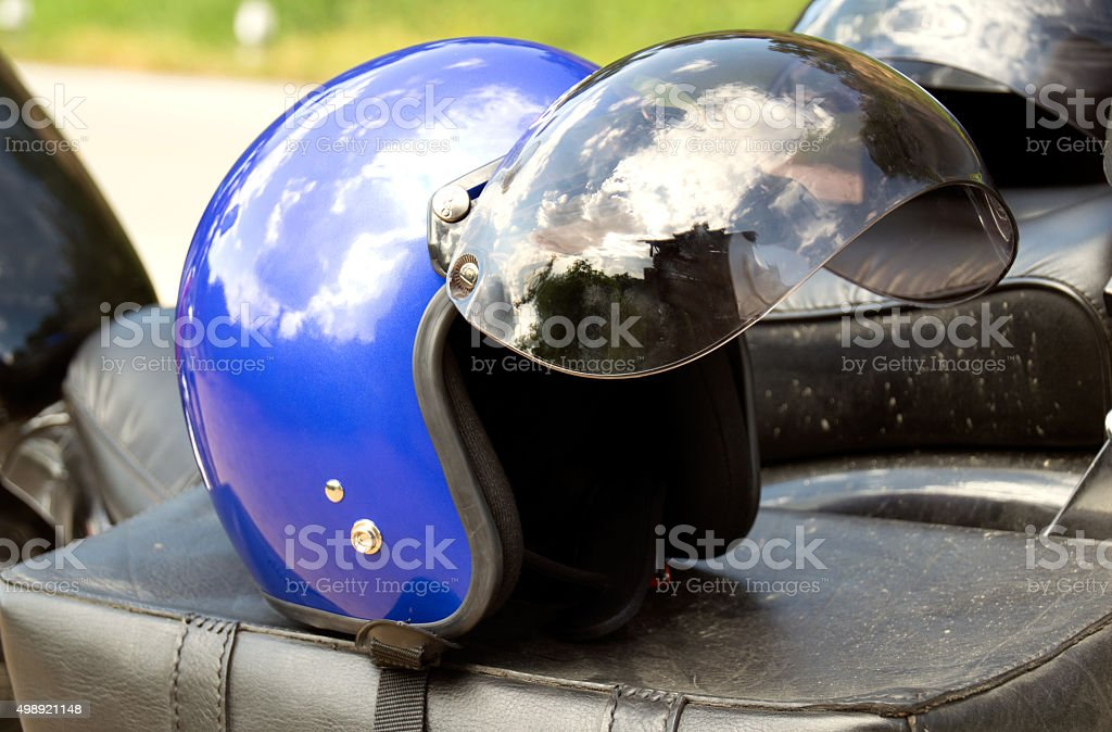 Blue helmet Put on the seat of a motorcycle chopper stock photo
