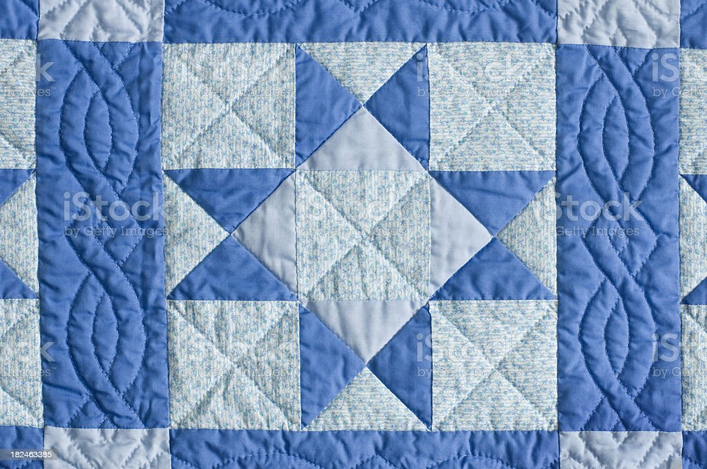 Blue home made quilt star pattern stock photo