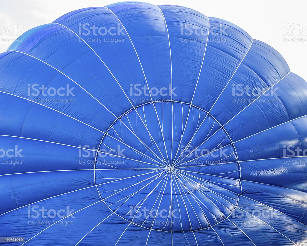 Blue hot air balloon launch preparation royalty-free stock photo
