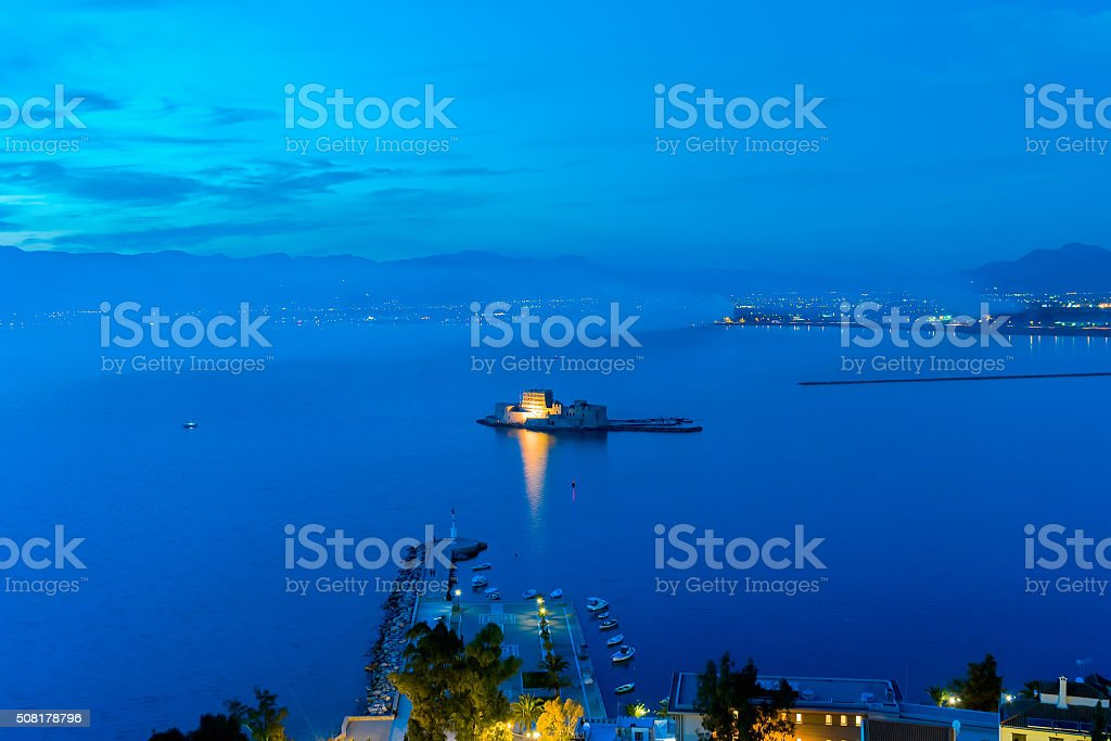 Blue hour of Bourtzi castle at Nafplio in Greece. stock photo