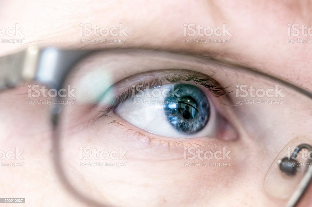 Blue Human Eye Wearing Glasses stock photo