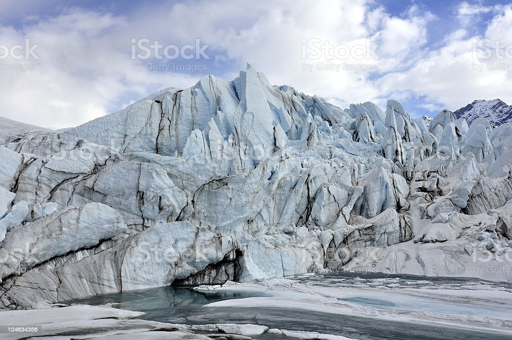 Blue ice and lake at a glacier stock photo