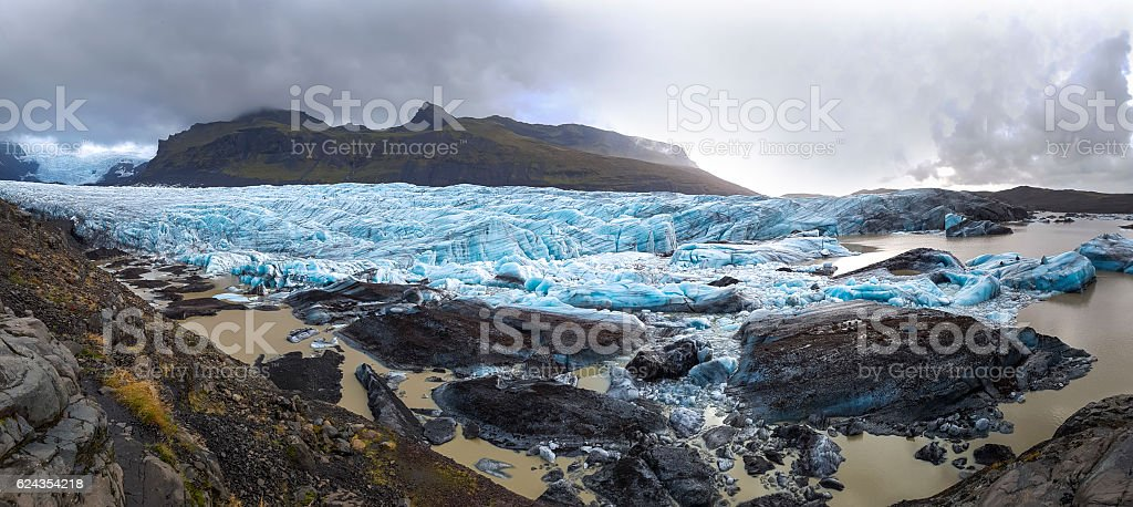 blue ice covered by snow and mountain peaks, Iceland stock photo