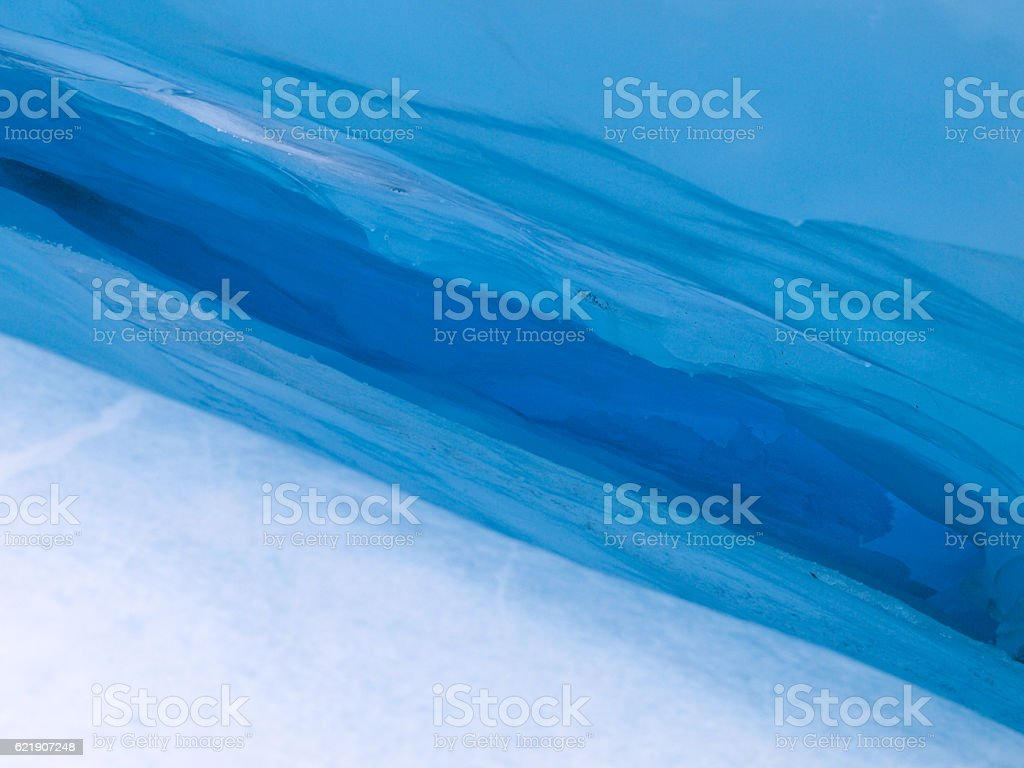 Blue ice hole stock photo