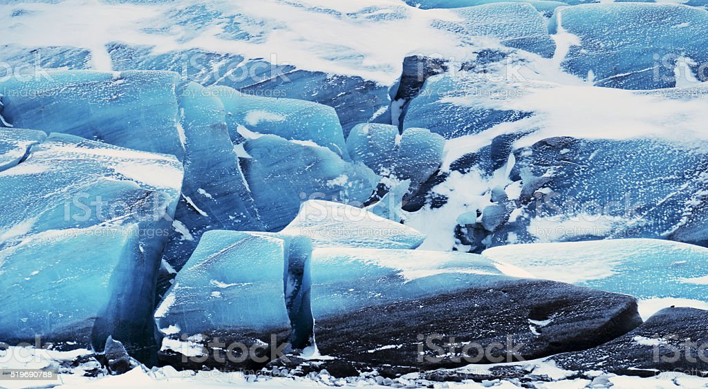 Blue ice of the Svinafell glacier in Iceland stock photo