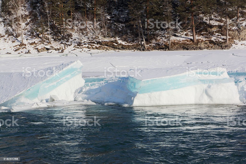 Blue ice on the thawing river , Altai, Russia stock photo