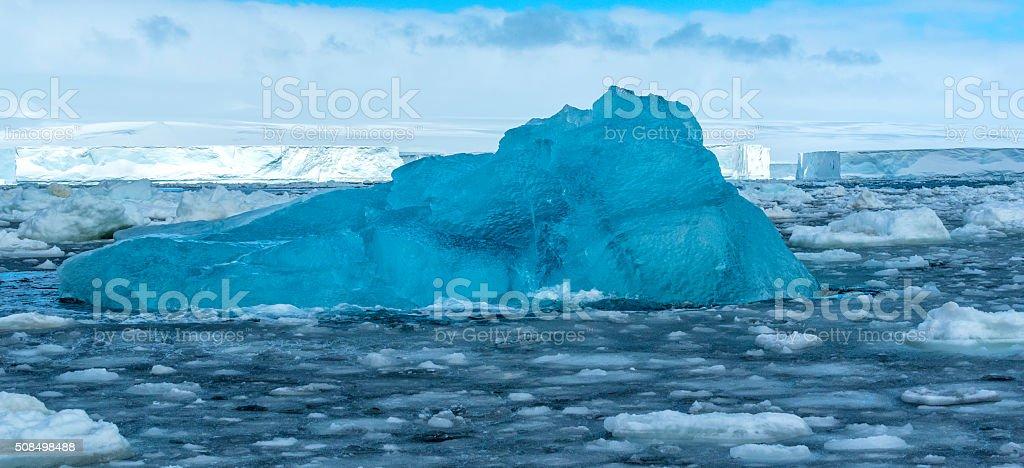 Blue Iceberg and Sea Ice in Antarctica stock photo