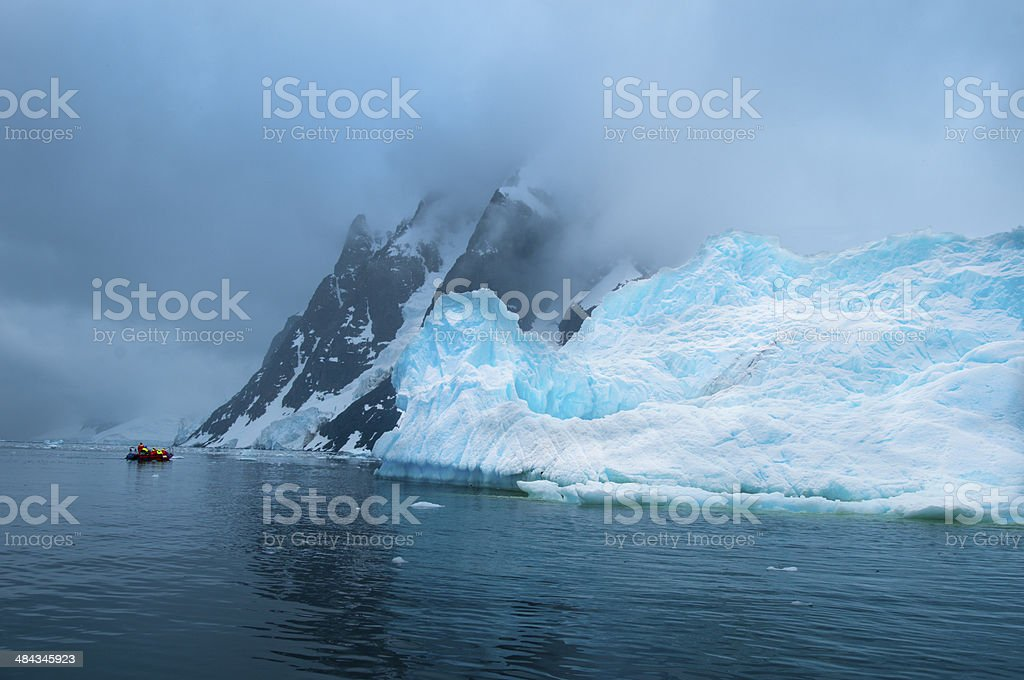 Blue Iceberg in Monochrome World stock photo