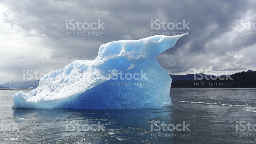 Blue Iceberg with dramatic lighting royalty-free stock photo