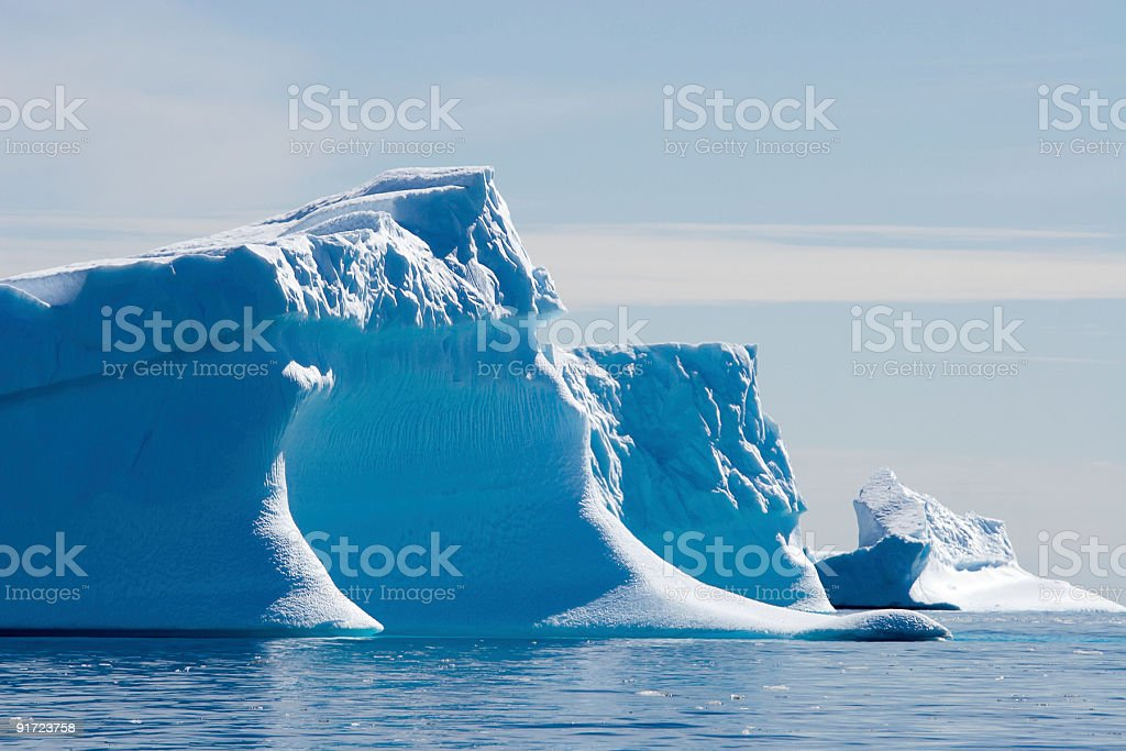 blue icebergs adrift stock photo