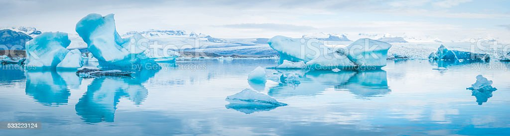 Blue icebergs calved from huge glaciers Arctic Ocean lagoon Iceland stock photo
