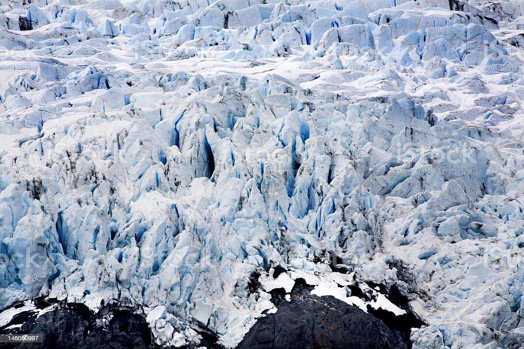 Blue Icy Portage Glacier with Rock and Crevaces Alaska stock photo