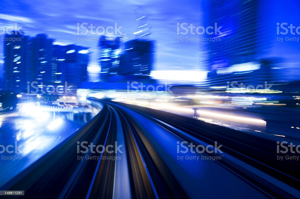 Blue image showing fast moving night traffic stock photo