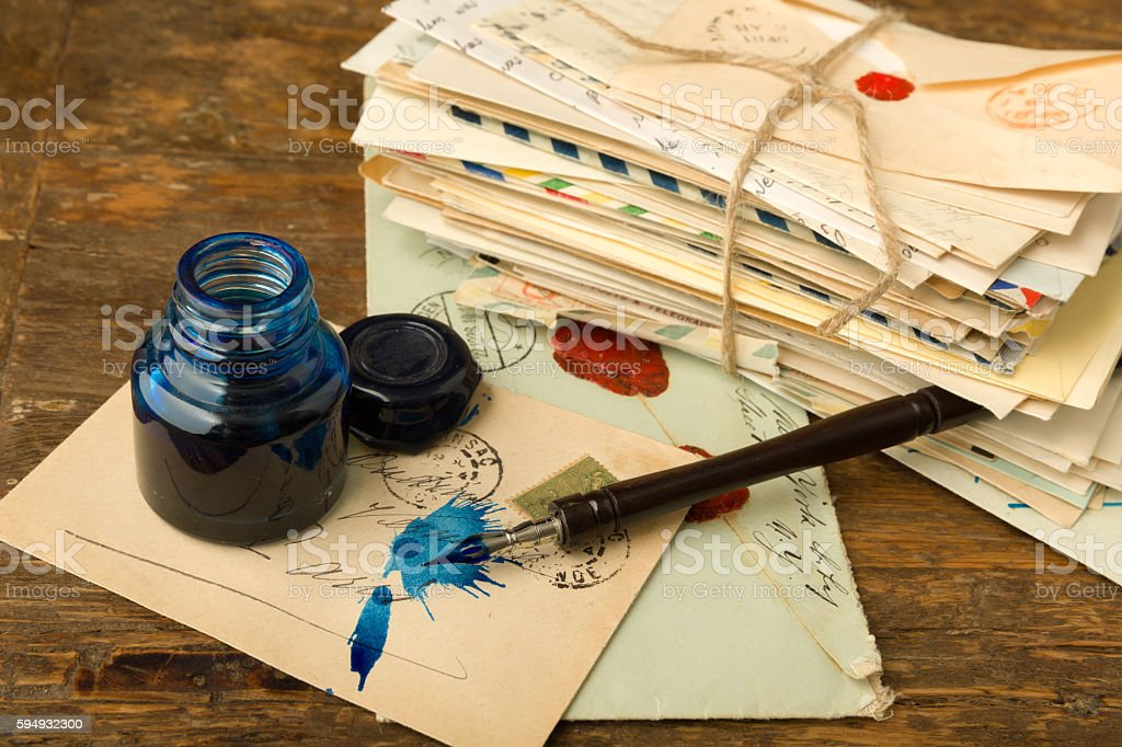 Blue ink and old letters stock photo
