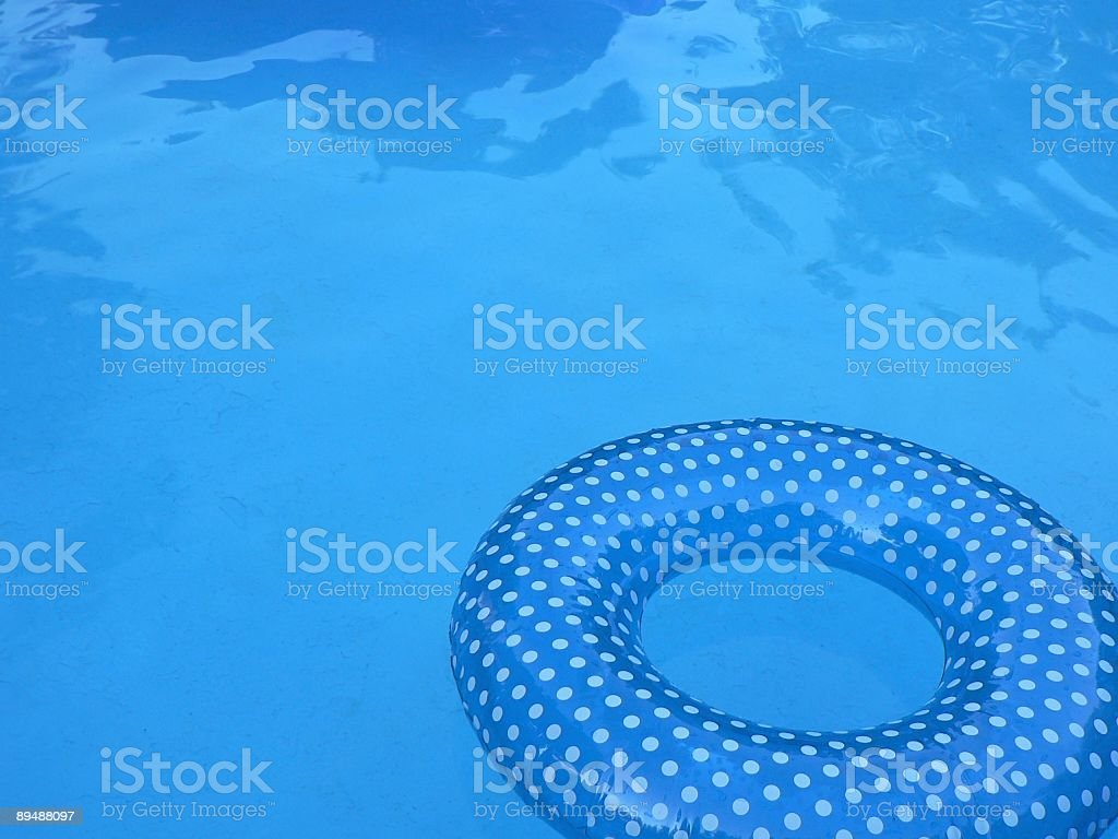 Blue Inner Tube in Swimming Pool 1 royalty-free stock photo
