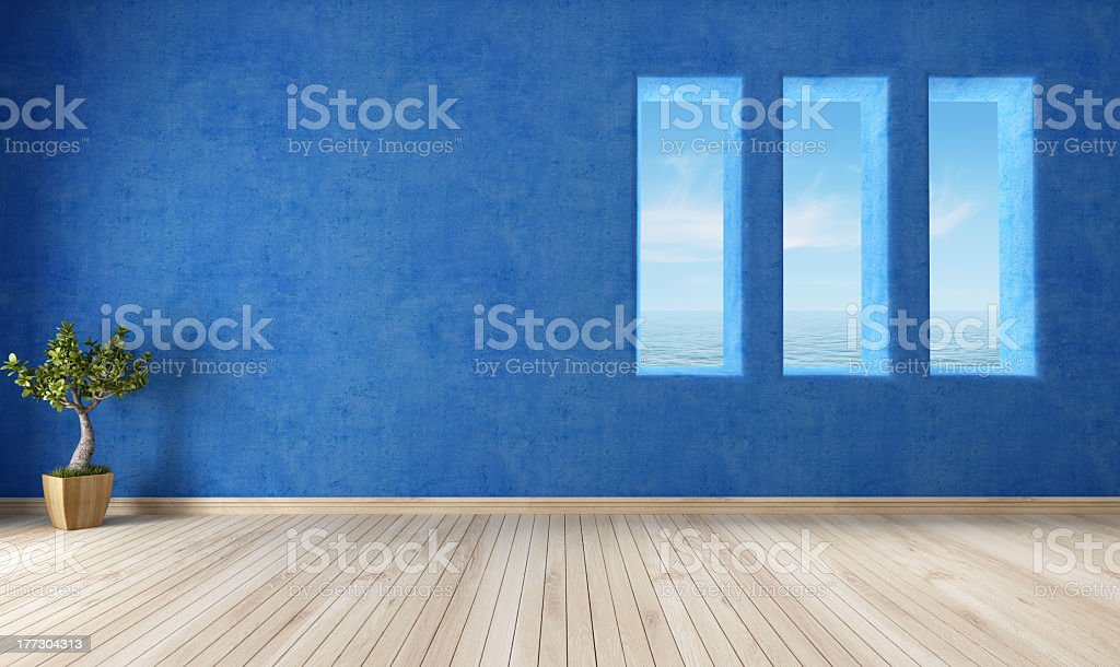 Blue interior with hardwood floors and plant royalty-free stock photo