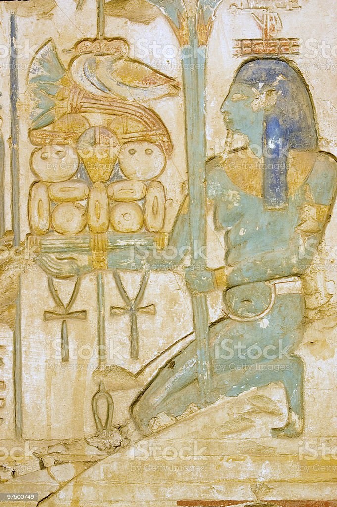 Blue Isis goddess with food tray stock photo