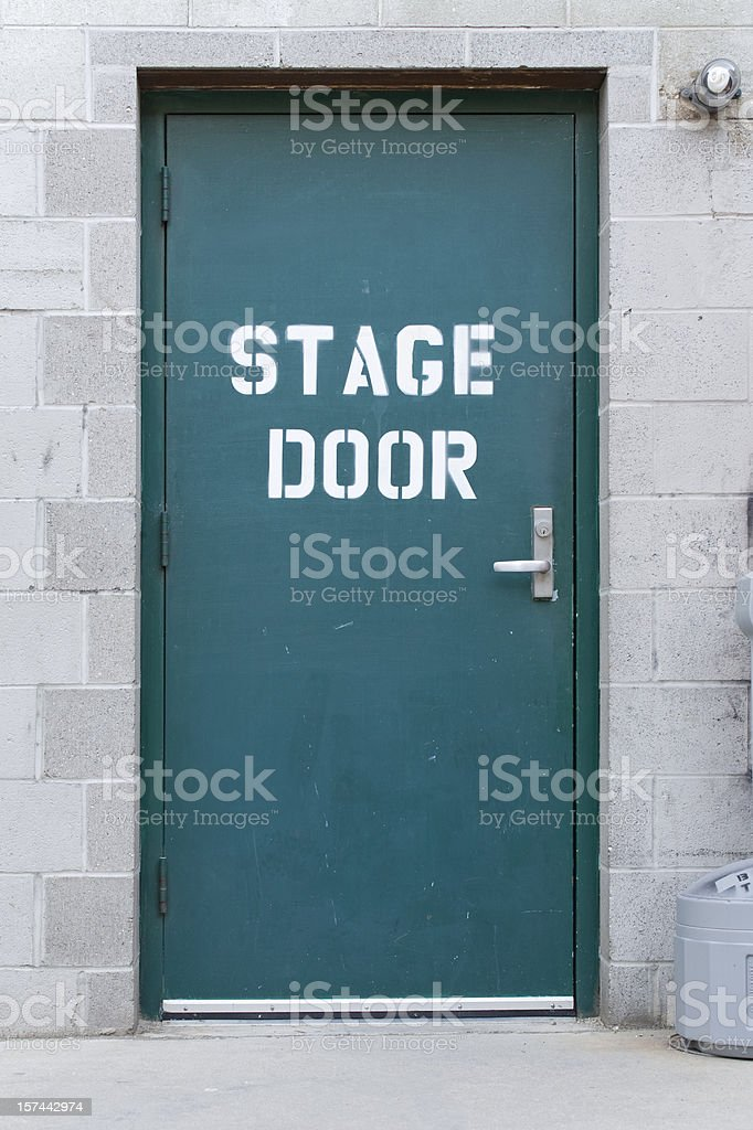 Blue isolated stage door on brick wall stock photo