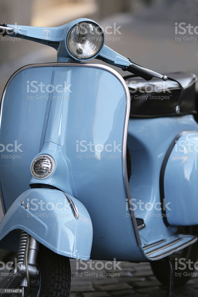 Blue Italian vintage scooter in Rome, Italy royalty-free stock photo