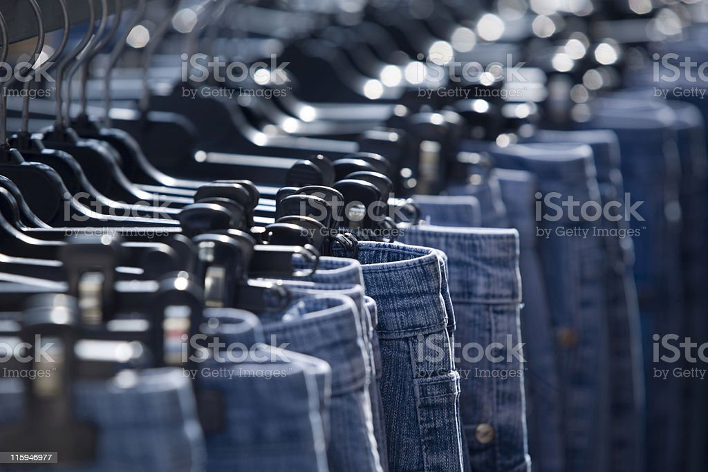 blue jeans hanging on a marketplace royalty-free stock photo