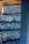 Blue jeans pile background