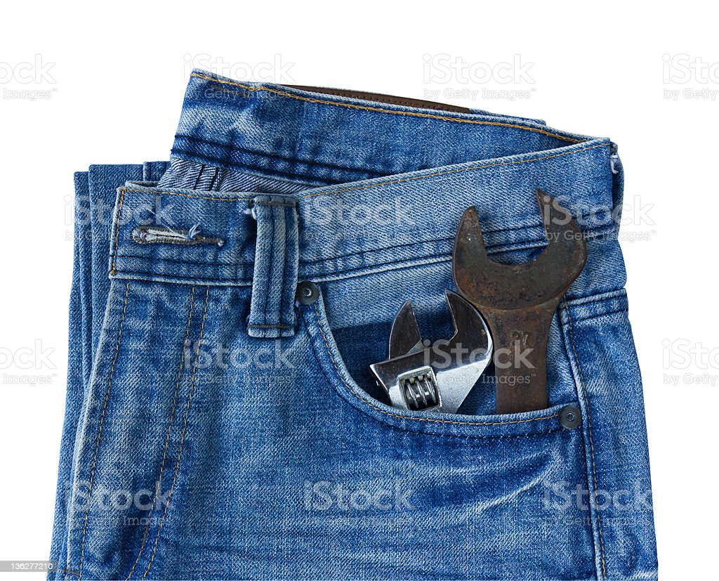 Blue jeans pocket with old tool royalty-free stock photo