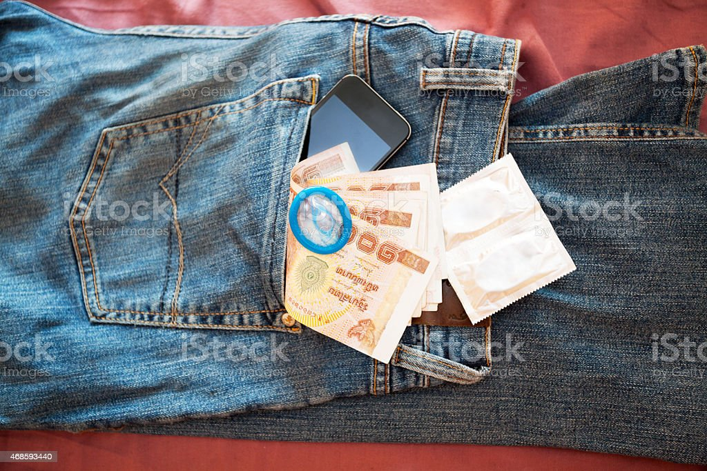 Blue jeans with all necessities for sextourism in Thailand stock photo