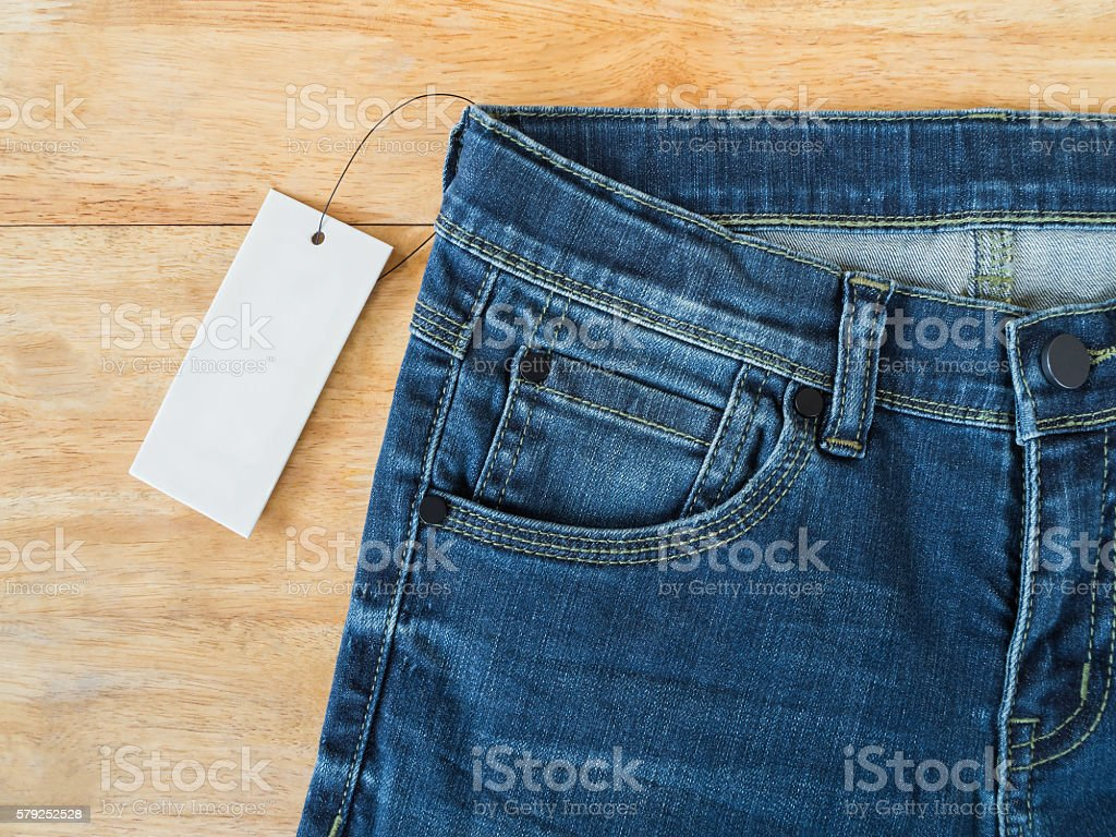 Blue jeans with white blank price tag stock photo