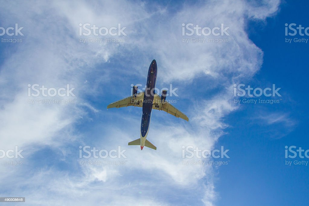 Blue Jet Plane landing with blue sky white clouds background stock photo
