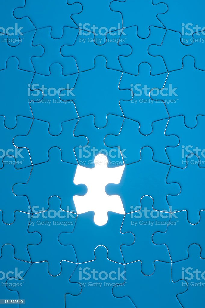 Blue jigsaw puzzle royalty-free stock photo