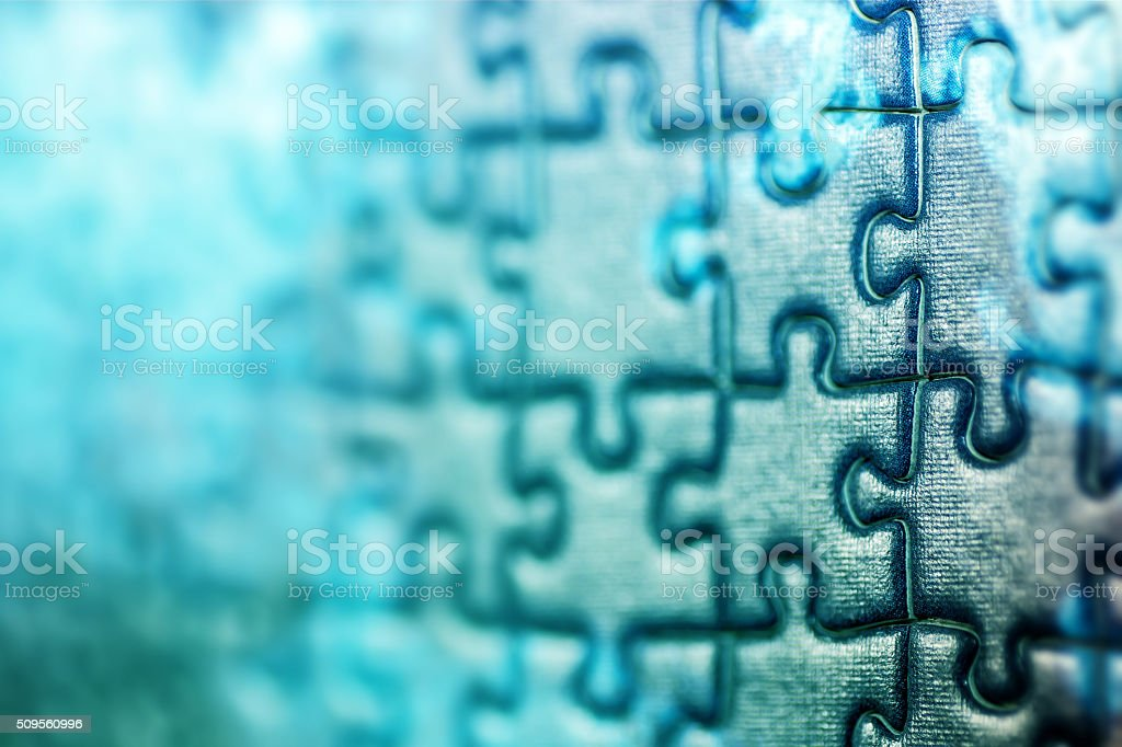 Blue jigsaw puzzle pieces macro in selective focus copy space stock photo