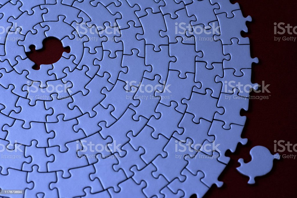 blue jigsaw with one missing piece laying aside royalty-free stock photo