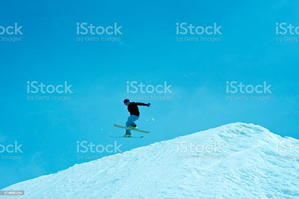 Blue jumper on skies stock photo