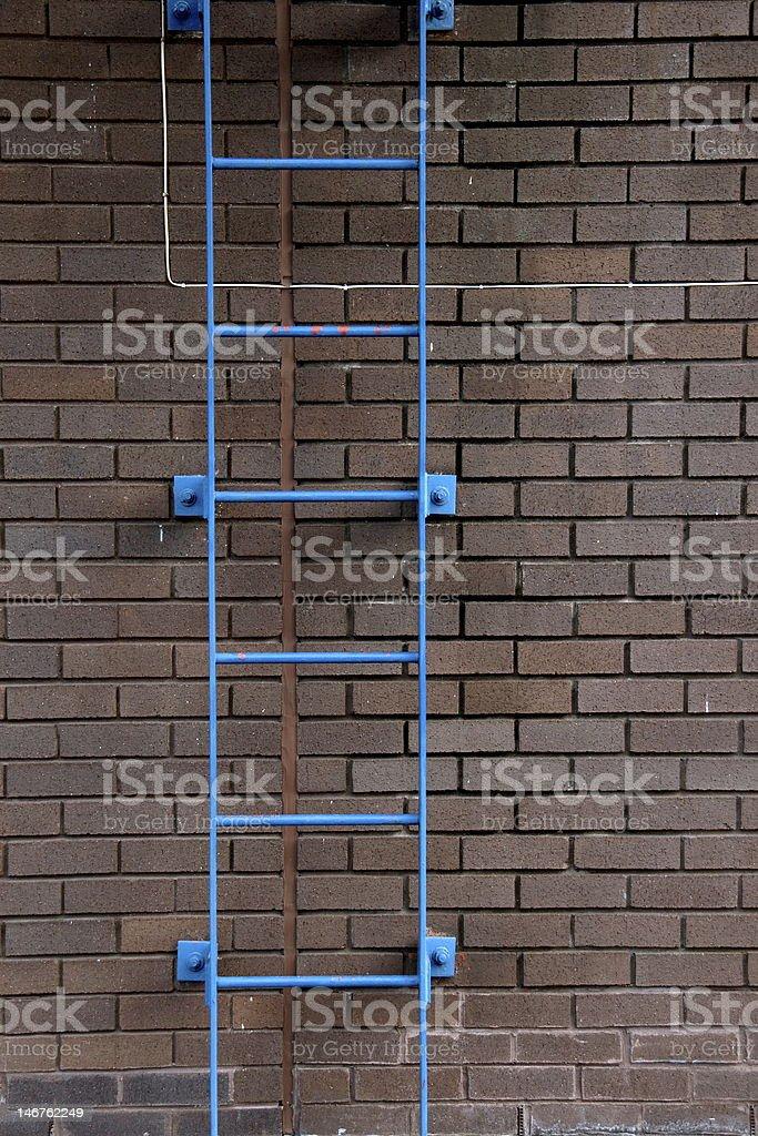 Blue Ladder and Brick Wall stock photo