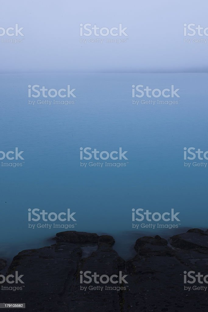 Blue lake at sunrise royalty-free stock photo