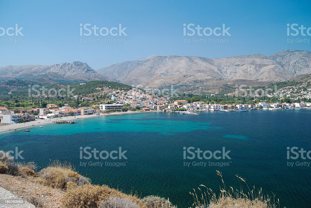 Blue lake by the town and mountains of Lagada, Chios stock photo