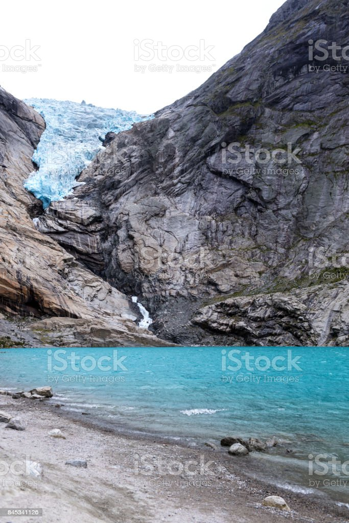 blue lake from glacier stock photo