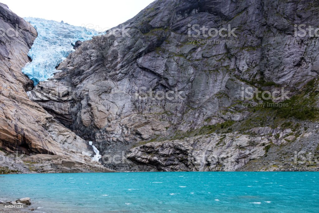 blue lake from norway glacier stock photo