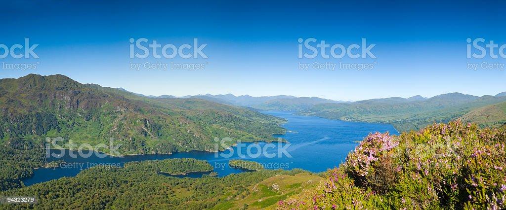 Blue lake, green mountains, purple heather royalty-free stock photo